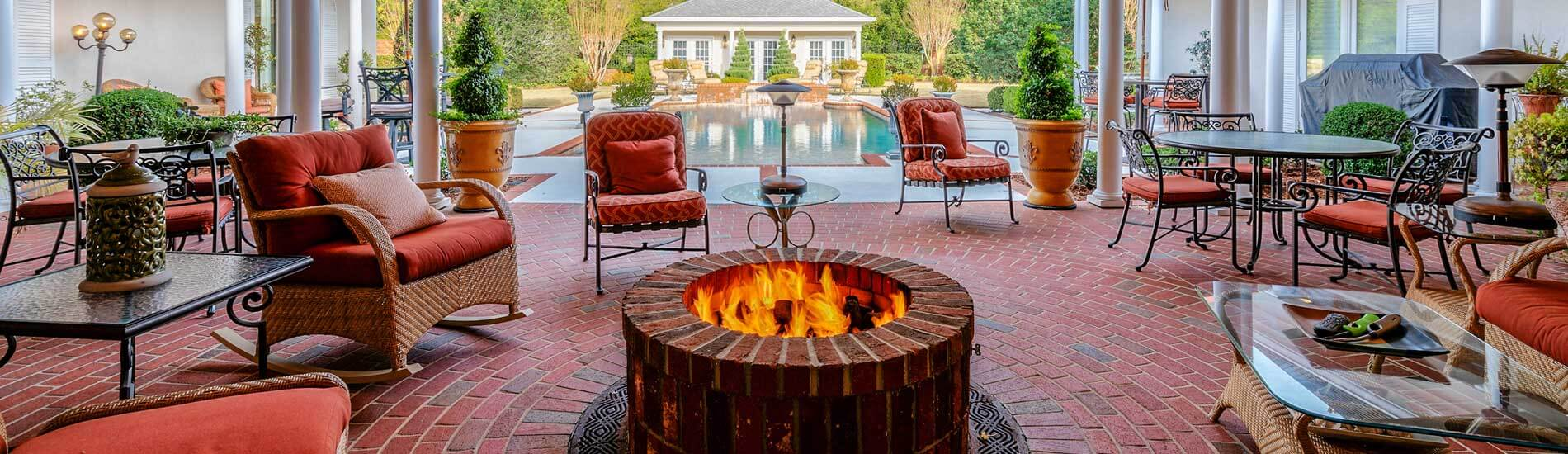 Fire pit under porch by pool | Greg Oldham Realtor Home Buying Selling Columbia County GA